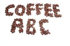 Grains de café ABC Images stock
