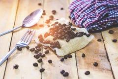 Grains de café d'histoire pendant le matin Photographie stock libre de droits