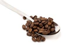 Grains de café dans la cuillère Photos libres de droits