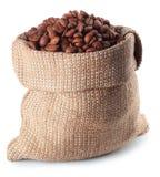 Grains de café dans le sac à toile de jute Image libre de droits