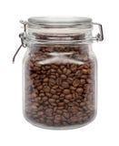 Grains de café dans une boîte métallique en verre Image stock