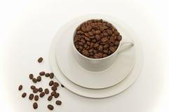 Grains de café dans une cuvette Photographie stock