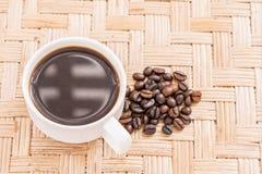 Grains de café de tasse de café Image libre de droits