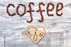 Grains de café et carton Photos libres de droits