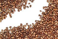 Grains de café et tasse de café Photographie stock libre de droits
