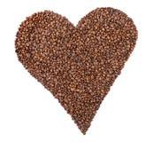 Grains de café - forme de coeur images stock