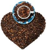 Grains de café rôtis en forme de coeur Photographie stock