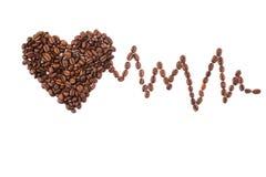 Grains de café rôtis sous forme de coeur Photos libres de droits
