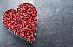 Grains de poivre roses (forme de coeur) Photos libres de droits