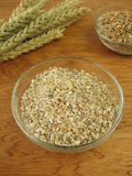 Grains an groats. In bowl Stock Images