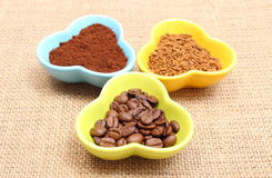 Grains, ground and instant coffee in colorful cups Royalty Free Stock Photography