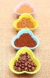 Grains, ground and instant coffee in colorful cups Stock Photography