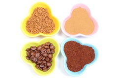 Grains, ground and instant coffee in colorful cups Stock Image