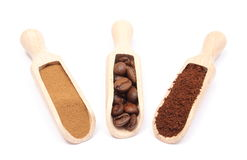 Grains, ground and instant coffee on wooden spoon Stock Photos