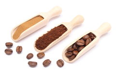 Grains, ground and instant coffee on wooden spoon Stock Images