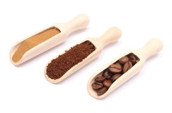 Grains, ground and instant coffee on wooden spoon Royalty Free Stock Images