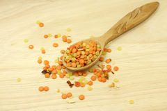 grains of peas and lentils in a wooden spoon Stock Image