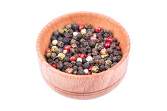 Grains of pepper in a bowl Stock Images