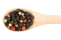 Grains of pepper in a spoon Royalty Free Stock Images