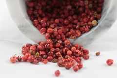 Pink pepper. Grains of pink pepper Royalty Free Stock Photography