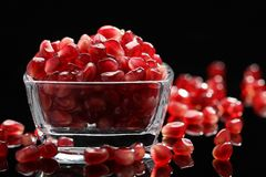 Grains of pomegranate in a glass bowl Royalty Free Stock Photo