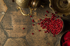 Grains of pomegranate on old paving stones Stock Image