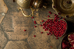 Grains of pomegranate on old paving stones Stock Images