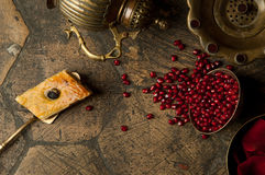 Grains of pomegranate on old paving stones Stock Photo