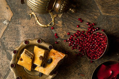 Grains of pomegranate on old paving stones Royalty Free Stock Photos