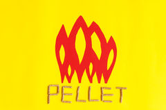 Grains of pressed wood forming the word pellet Stock Images