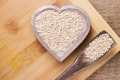 Grains of quinoa on wood Stock Photography