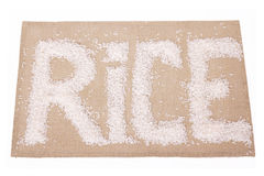 Grains of rice in the form of inscriptions Royalty Free Stock Photos