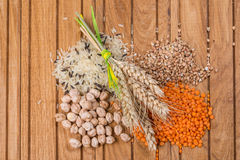 Grains of rice, lentils, buckwheats and chickpeas with wheat ears Royalty Free Stock Photography