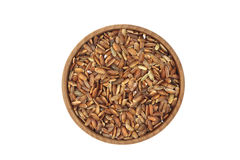 Grains of rice in a wooden bowl Stock Image