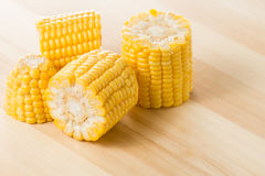 Grains of ripe corn on wood table Stock Images