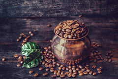 Grains of roasted coffee in a copper pot Stock Photos