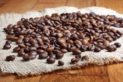 Grains of roasted coffee on linen napkin Royalty Free Stock Image