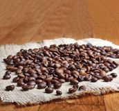 Grains of roasted coffee on linen napkin Stock Images
