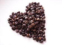 Grains roasted coffee in the shape of heart on  white plate Stock Photo