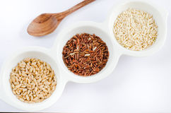 Grains and spoon Stock Photos