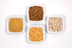 Grains in white bowls Stock Image