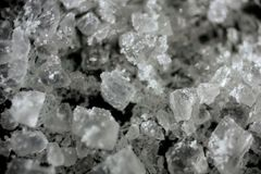 Grains of white stone sea salt in macro. Salty. Small. Cooking and Ingredients stock images