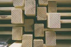 Grainy background image,pile of wood stack for D.I.Y furniture stored at warehouse Royalty Free Stock Photos