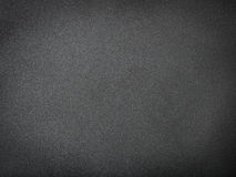 Grainy black textured background with spotlight. Close up Grainy black textured background with spotlight Royalty Free Stock Photo