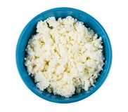 Grainy cottage cheese in blue bowl isolated on white Royalty Free Stock Photos