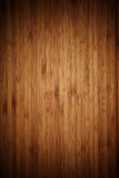 Grainy dark wooden background Stock Images