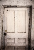 Grainy Image of Old, Dirty, Rotting Panel Door Stock Photography