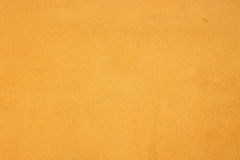 Grainy Plastered Texture of Blank Yellow Dry Wall Stock Photography
