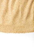 Grainy sand. Closeup of grainy sand isolated on white background with copy space stock photography