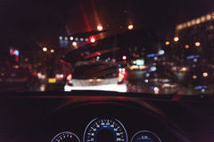 Grainy style of car console, waiting in a traffic jam at night w Royalty Free Stock Images
